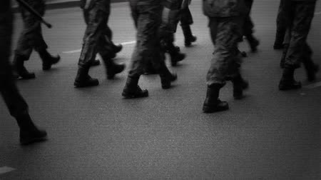 mobilization : Marching soldiers on the street.