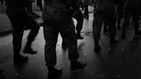 mobilization : Group of soldiers walking down the street.