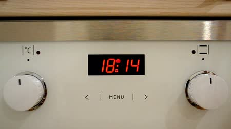 combinado : oven digital clock indicates the time