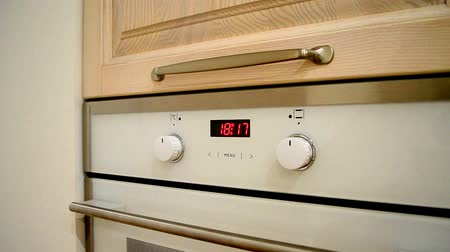 benzer : oven digital clock indicates the time