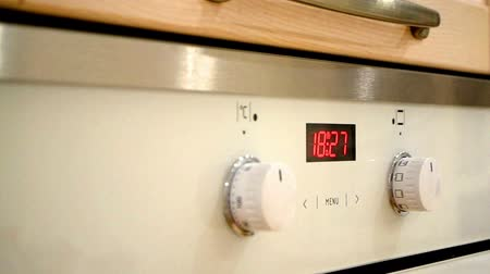oven digital clock indicates the time