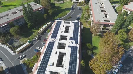 kolektor : Installation of Photovoltaic Solar Panels on Retirement Building, Aerial View. Renewable and Sustainable Energy Concept
