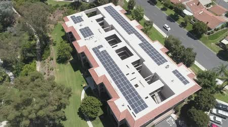 kolektor : Solar Panel Array System on Top of building complex, Aerial View. Modern Technology, Alternative Energy