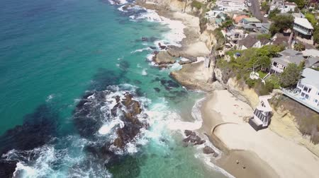 megye : Victoria beach, drone aerial birds eye view descending above colorful coastal houses rooftops along shoreline, Laguna