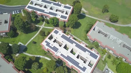 gyűjtő : Birds Eye Aerial View of large complex with Solar Panels Renewable Energy Array System, California USA