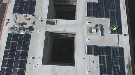 kolektor : Workers on Solar Panel Project Installation on Top of Building, Birdseye Aerial View, Energy Concept