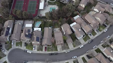 megye : Aerial, drone shot overlooking neighborhood houses, tennis court and pools, Santa Clarita, California