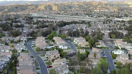 megye : Aerial drone rising of Santa Clarita residential neighborhood during sunset, California Stock mozgókép