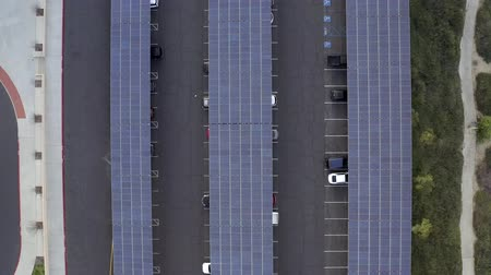 Solar panels in parking lot, aerial birds eye panning, in Los Angeles, California