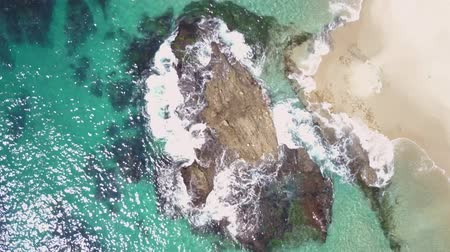 Top Down Aerial View of Ocean Waves Breaking on Rock at Victoria Beach, Laguna, California Wideo