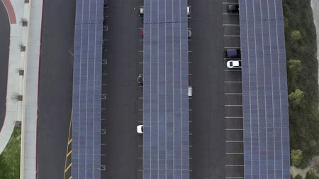Solar panel project on car park roof, Santa Clarita, California, rising drone Wideo