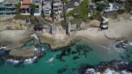 megye : Victoria beach coast, Aerial Orbit above colorful urban coastal house rooftops and Pirate Tower, Laguna