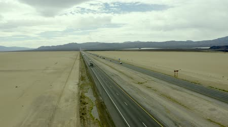eyaletler arası : Trucks and vehicles driving along Interstate Fifteen in Mojave Desert, aerial