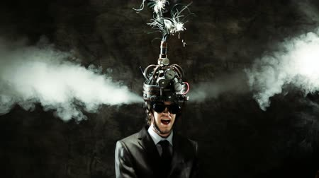 persuasion : Business man wearing a brain-control helmet, forced ideas extraction