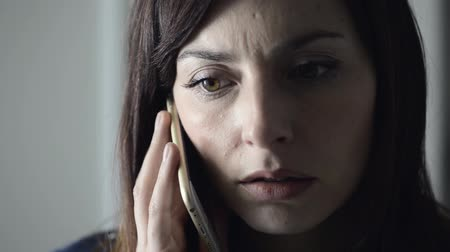 stres : Nervous pensive woman having a phone call, close up