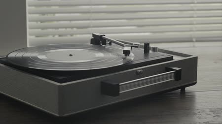 tonearm : Vintage turntable record player and vinyl record playing music, retro revival and entertainment concept Stock Footage