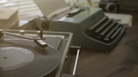 tonearm : Vintage desk with record player and typewriter, relaxation and entertainment concept, loop video