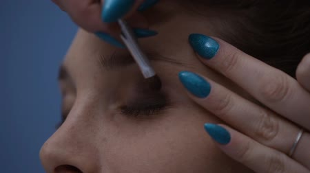 dab : Professional make up artist applying make up on a womans face and final result, beauty and cosmetics concept, video montage Stock Footage