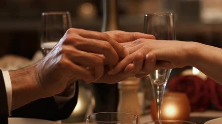 eleganckie : Romantic couple dining together, man giving a precious engagement ring to his girlfriend