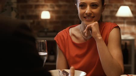 функция : Young happy couple having a date in elegant restaurant, the woman is smiling and laughing, relationships and lifestyle concept