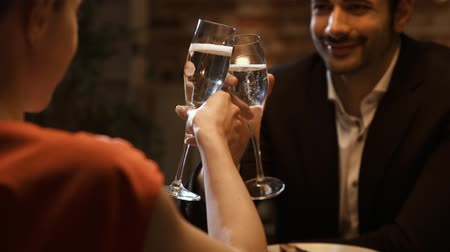 nişanlısı : Romantic couple having a date at the restaurant, they are drinking wine together and smiling, love and relationships concept Stok Video