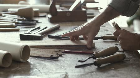 rasp : Professional skilled carpenter working on a woodworking joint and filing wood, crafts and carpentry concept