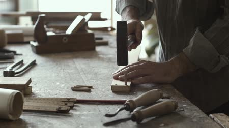 dowel : Skilled carpenter and woodworking concept