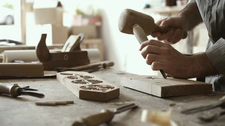 gabela : Professional skilled carpenter at work, he is carving wood using hammer and chisel, woodworking and carpentry concept Stock Footage