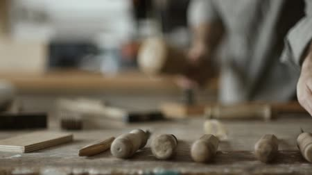 ustalık : Professional skilled carpenter carving wood using mallet and chisel and woodworking tools in the foreground