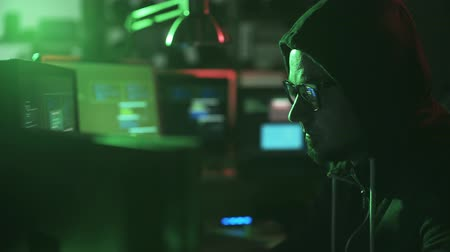 spying : Professional hacker and developer working at night in his basement, he is cracking systems and stealing data, cyber crime and hacking concept Stock Footage