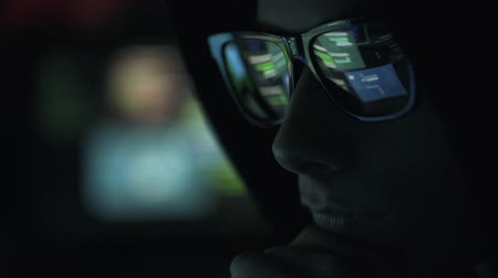 cauda : Young nerd hacker with glasses connecting online and stealing data, cyber crime and hacking concept Stock Footage