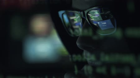 operational system : Young nerd hacker with glasses connecting online and stealing data, cyber crime and hacking concept Stock Footage