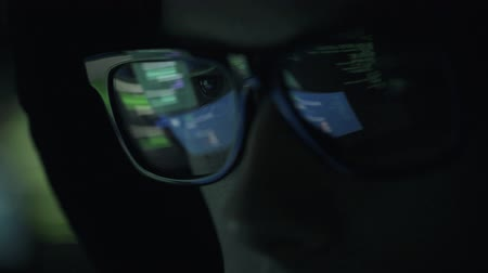 spying : Young nerd hacker with glasses connecting online and stealing data, cyber crime and hacking concept Stock Footage