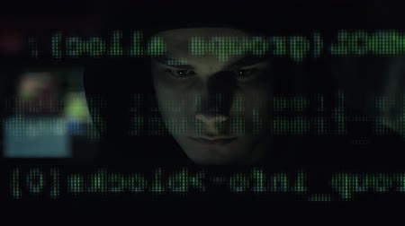 operational system : Young hacker with hoodie connecting his computer and running on the screen, hacking and malware concept