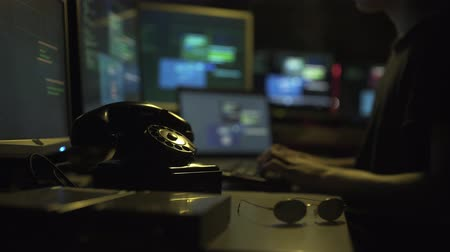 operational system : Hacker working in the dark and stealing data, hacking and sci-fi concept Stock Footage