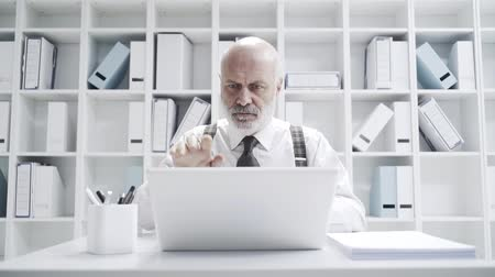 adminisztrátor : Angry stressed mature businessman breaking his laptop, he is having problems with his computer
