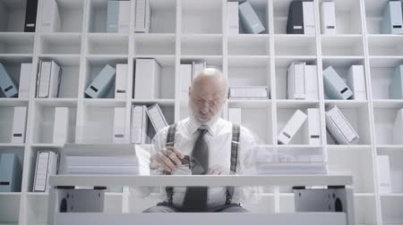 administrador : Office worker doing a boring repetitive job: he is a pile of paperwork, video montage