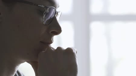 doubt : Pensive woman with glasses