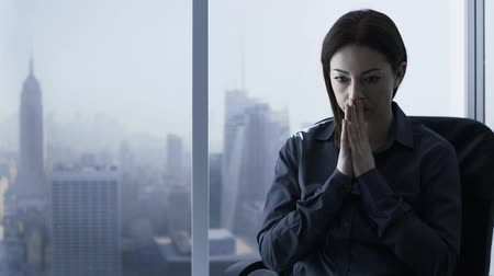 aureool : Stressed concerned businesswoman in her office, she is sitting, thinking and finding solutions to her problem