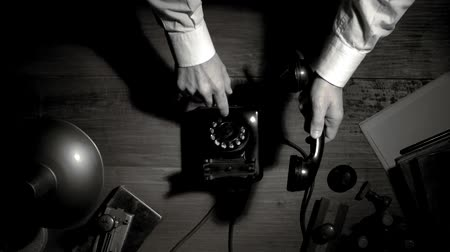 ahize : Noir film businessman making a phone call at night with a rotary dial telephone, suspense and thriller concept, flat lay desktop