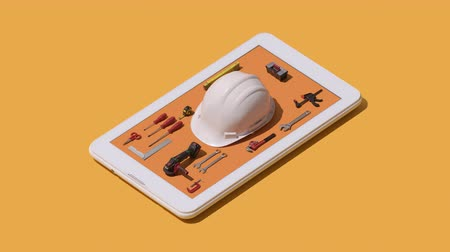 montáž : Work safety and equipment app: isometric tools on a smartphone
