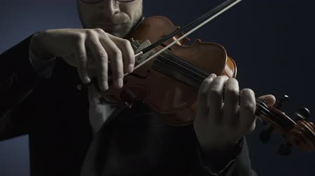 philharmonic : Professional musician playing violin on stage close up, classical music concept Stock Footage