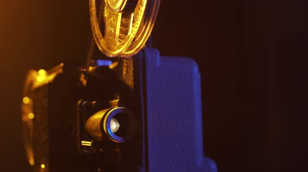 cinematography : Vintage fashioned projector in a dark room projecting a film, cinematography concept Stock Footage