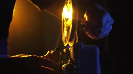 video reel : Operator rewinding a vintage film reel on a projector, cinematography concept
