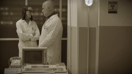 sepia : Scientific team working in the laboratory and discussing together, sci-fi computer with leds in the background, vintage style Stock Footage