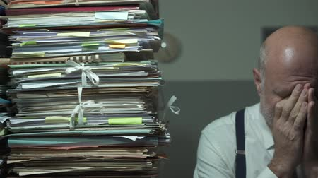 bürokrasi : Stressed depressed businessman with lots of paperwork, business management and deadlines concept Stok Video
