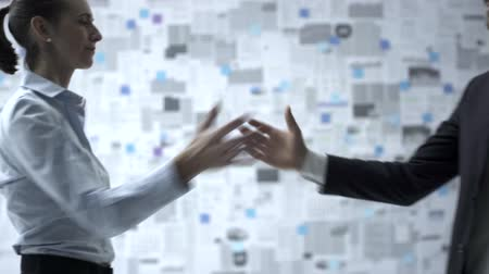 güvenilirlik : Business people giving handshake to a homie, wall covered with financial reports in the background, trust and reliability concept