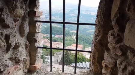 дверь : Ancient terrifying jails in italian castle with views through the bars