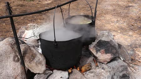 open hearth : Cooking in a bucket on fire