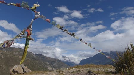 prayer flag : Waving Colorful Prayer Flags in Nepal, Annapurna Circuit Stock Footage